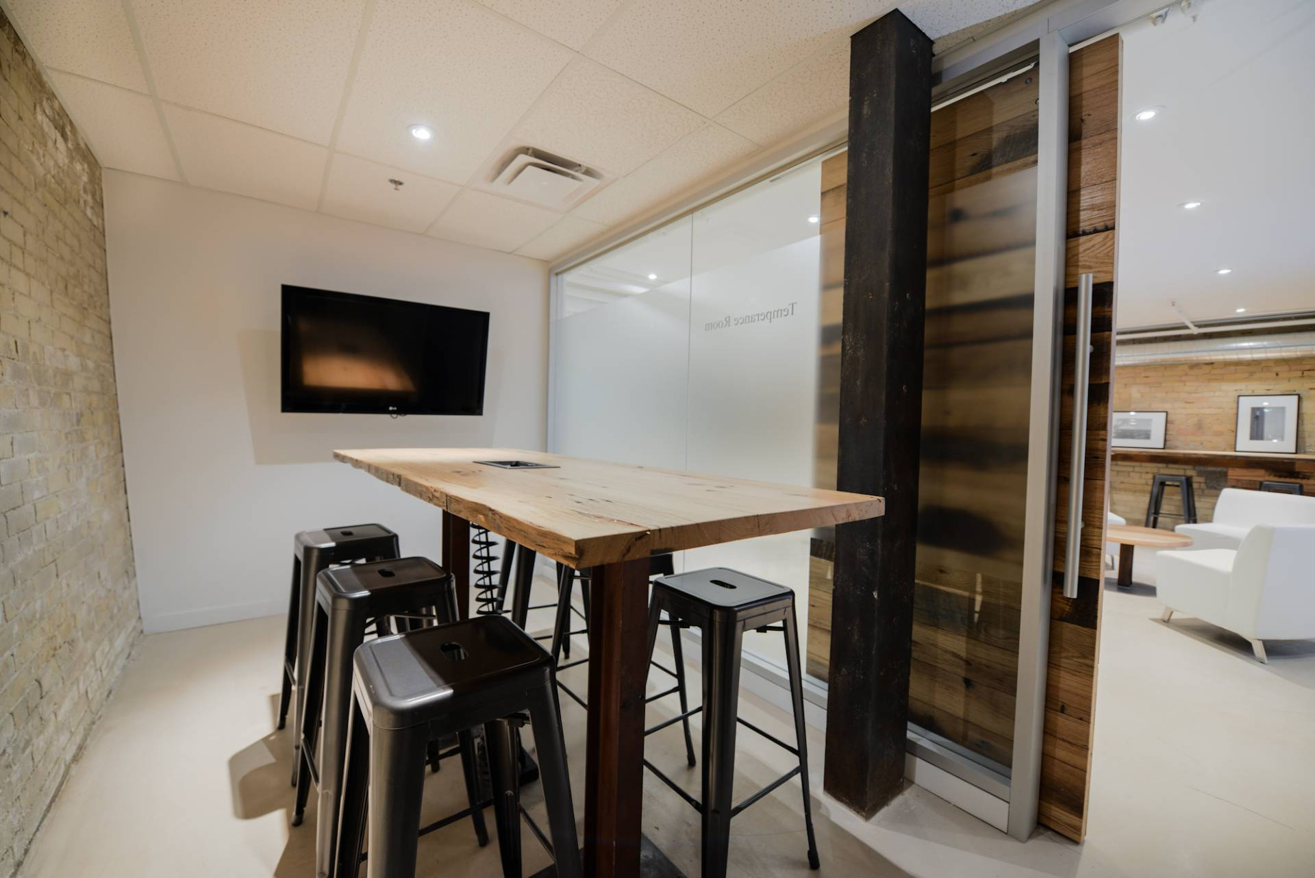 Wooden Bar Table with Stools in meeting room