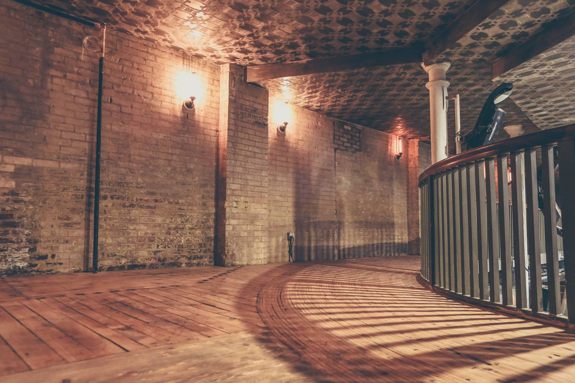 Brickwalls with a rustic hardwood floor