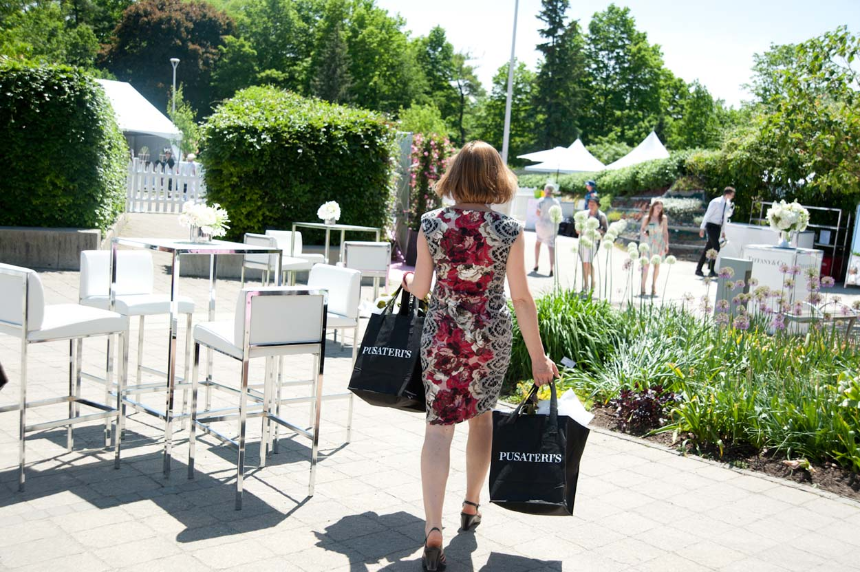 Women Carrying two bags outside on a sunny day at the Toronto Botanical Gardens