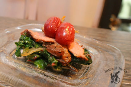 Thinly sliced duck breast over kale tossed with caramelized onion, topped with house-made raisins.